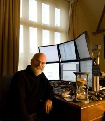 Terry Pratchett at his desk